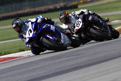 Josh Hayes leads Ben Bostrom on the final lap enroute to a win