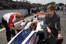 Jonathan Palmer CEO MotorSport Vision, has a word with pole sitter Kazim Vasiliauskas on the grid