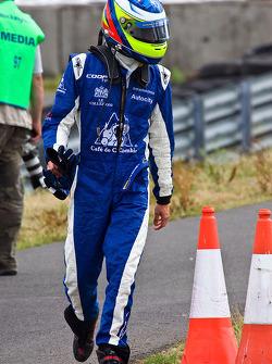 Carlos Huertas walks back to the pits