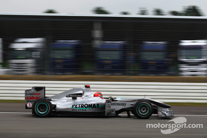 Michael Schumacher, Mercedes GP passing lorries that would normally be in the paddock