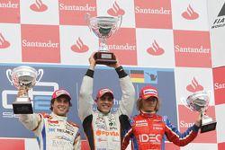 Pastor Maldonado celebrates his victory on the podium with Sergio Perez and Charles Pic