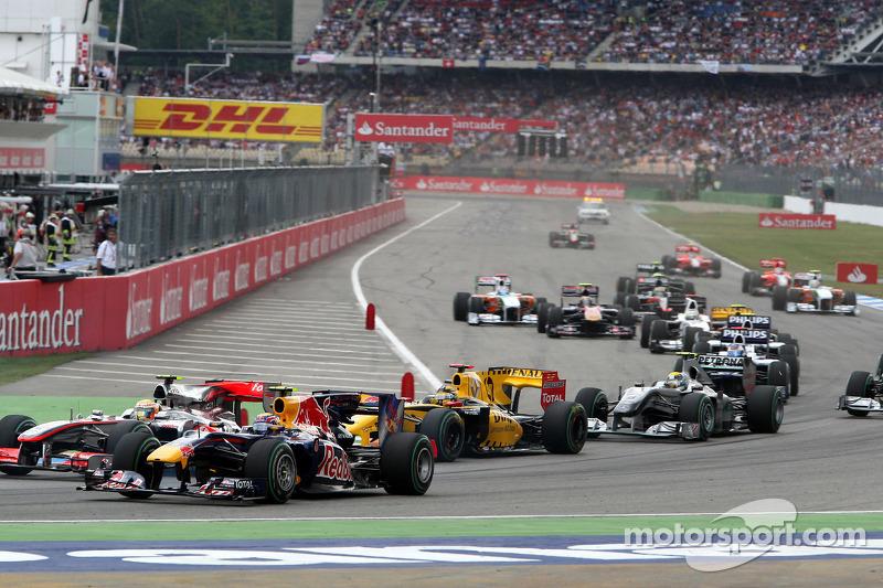Lewis Hamilton, McLaren Mercedes and Mark Webber, Red Bull Racing at the start