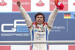 Sergio Perez celebrates his victory on the podium