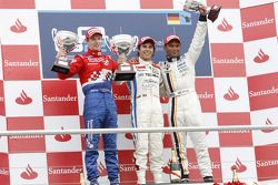 Sergio Perez celebrates his victory on the podium with Davide Oliver Turvey and Adrian Zaugg