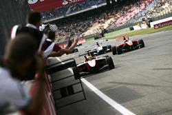 Esteban Gutierrez celebrates victory in front of the team