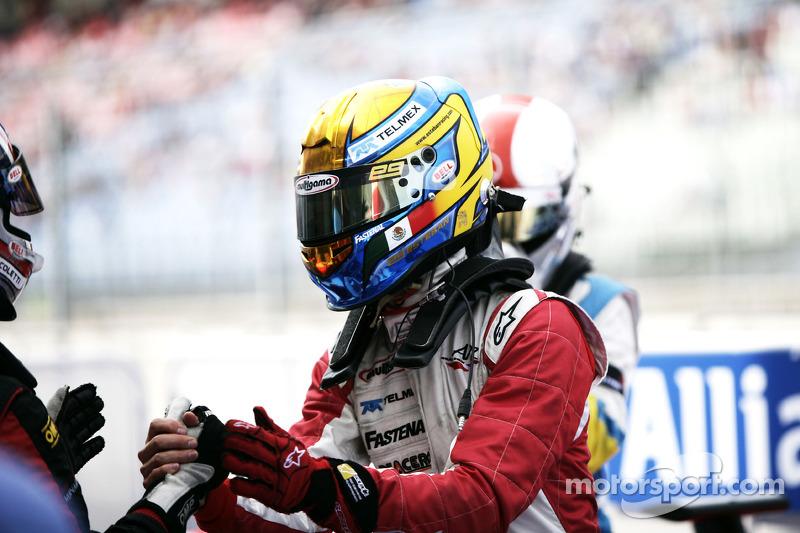 Esteban Gutierrez celebrates victory in parc ferme with Stefano Coletti