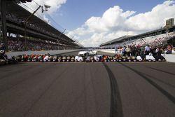 Race winner Jamie McMurray, Earnhardt Ganassi Racing Chevrolet and his team kiss the Yard of Bricks
