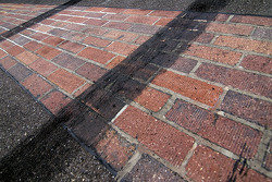 Tires marks on the Yard of Bricks