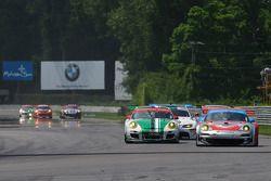 #44 Flying Lizard Motorsports Porsche 911 GT3 RSR: Darren Law, Seth Neiman, #54 Black Swan Racing Po