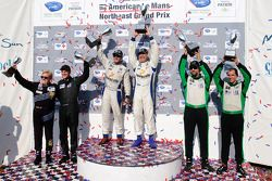 GTC class podium: class winners Henri Richard and Andy Lally, second place Timothy Pappas and Jeroen