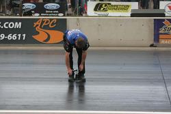 Crew members check the track status between runs