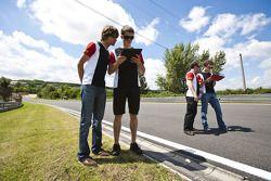 Esteban Gutierrez and Pedro Nunes on a track walk with the team