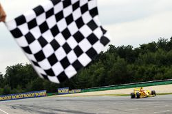 Benjamin Bailly takes the chequered flag