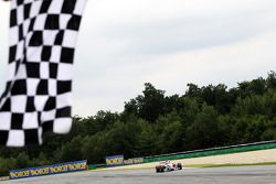 Jolyon Palmer takes the chequered flag