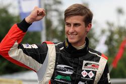 Race winner Nicola de Marco celebrates in parc ferme
