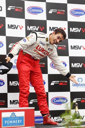 Second place Sergey Afanasiev celebrates on the podium