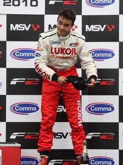 Sergey Afanasiev celebrates on the podium