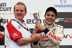 Jonathan Palmer CEO MotorSport Vision on the podium with Sergey Afanasiev