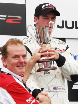 Dean Stoneman celebrates on the podium with Jonathan Palmer CEO MotorSport Vision