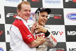 Sergey Afanasiev celebrates on the podium with Jonathan Palmer CEO MotorSport Vision