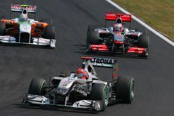 Michael Schumacher, Mercedes GP y Jenson Button, McLaren Mercedes