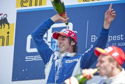 Giacomo Ricci celebrates his victory on the podium
