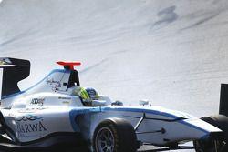 Felipe Guimaraes flies over the back of Michael Christensen