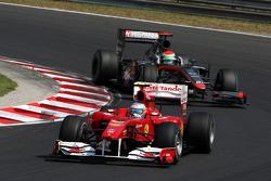 Fernando Alonso, Scuderia Ferrari leads Sakon Yamamoto, Hispania Racing F1 Team
