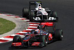 Jenson Button, McLaren Mercedes leads Kamui Kobayashi, BMW Sauber F1 Team