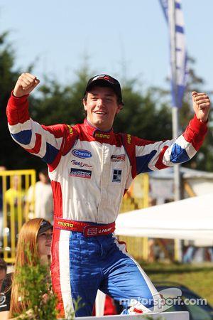 Winner of race two Jolyon Palmer celebrates in Parc ferme