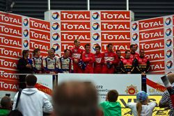 Podium: race winners Romain Dumas, Jörg Bergmeister, Martin Ragginger and Wolf Henzler