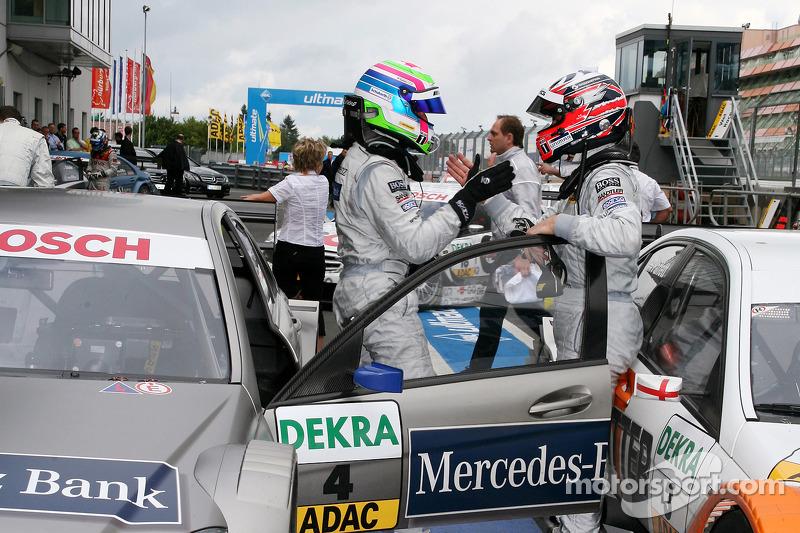 Race winnaar Bruno Spengler, Team HWA AMG Mercedes C-Klasse met 2de plaats Paul di Resta, Team HWA AMG Mercedes C-Klasse