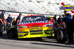 The Dupont crew changes four tires on Jeff Gordon's car after he wrecks