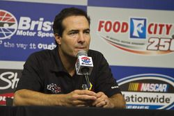 Funny car driver Ron Capps speaks in the media center