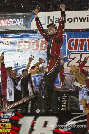 Victory lane race winner Kyle Busch celebrates