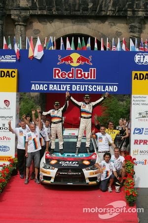 Podium: Armindo Araujo and Miguel Ramalho, Mitsubishi Lancer Evo X, Ralliart Italy