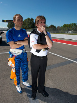 Max Angelelli and Wayne Taylor wait for the return of the crashed #30 Racers Edge Motorsports Mazda RX-8