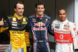 Pole winner Mark Webber, Red Bull Racing, second place Lewis Hamilton, McLaren Mercedes, third place