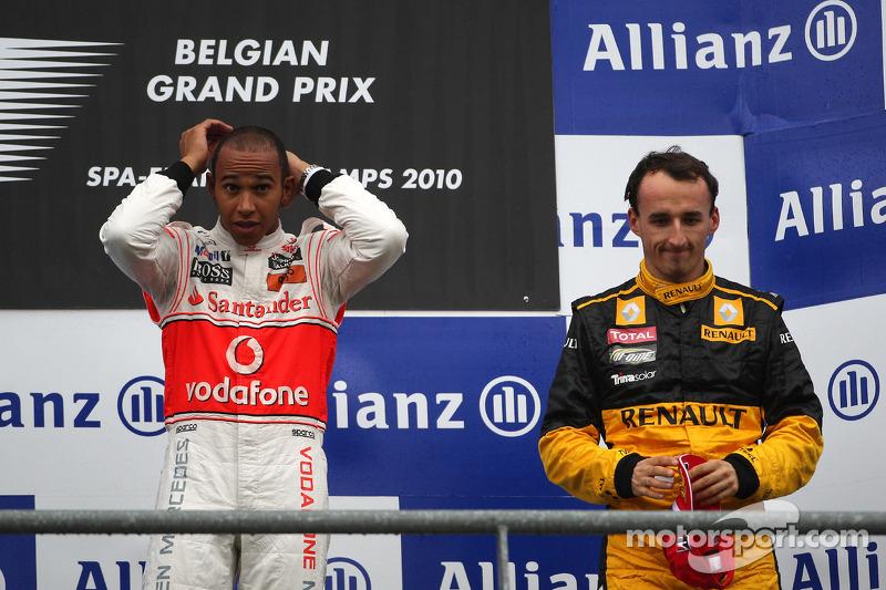 Ao seu lado na terceira posição, Robert Kubica