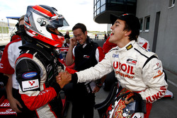 Sergey Afanasiev, scored pole position for race 1 and is congratulated by third placed Nicola de Mar