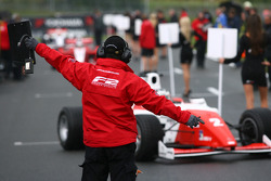 Cars are directed to their grid positions