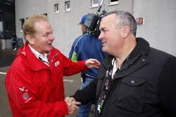 Jonathan Palmer, CEO MotorSport Vision, congratulates the father of Dean Stoneman