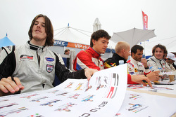 Will Bratt and Jolyon Palmer in the autograph session