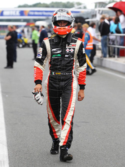 Nicola de Marco walks back to the pits after retiring from second place
