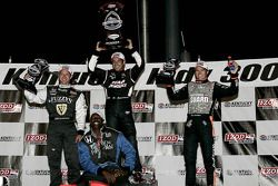 Podium: race winner Helio Castroneves, Team Penske, second place Ed Carpenter, Panther Racing/Vision
