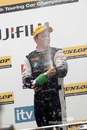 Steven Kane sprays champagne