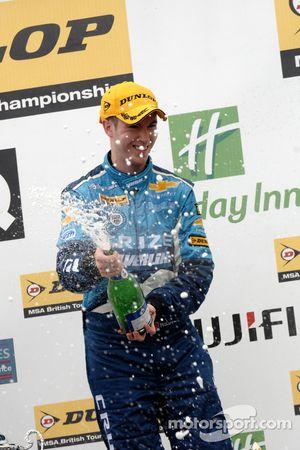 Alex MacDowall sprays champagne