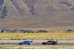 #40 Dempsey Racing Mazda RX-8: Charles Espenlaub, Joe Foster and #46 Autohaus Motorsports Camaro GT.R: Jordan Taylor, Johnny O'Connell