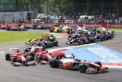 Start: Jenson Button, McLaren Mercedes passes Fernando Alonso, Scuderia Ferrari