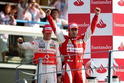 Podium: race winner Fernando Alonso, Scuderia Ferrari, second place Jenson Button, McLaren Mercedes